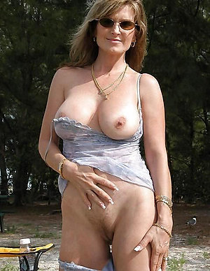 Beautiful natural older wife shows nipples