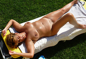 Hot old slut on the beach pics