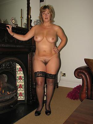 Busty adult women in high heels leafless photo