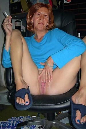 Busty mature milf masturbating naked pics