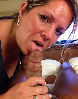 Pretty wife giving husband blowjob photos