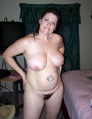 Naughty tattooed mature naked pictures