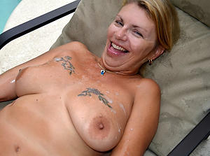 Hot porn of sexy tattooed mature