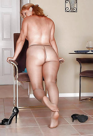 Gorgeous mature woman in pantyhose photo