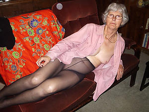 Naughty mature woman in pantyhose photo