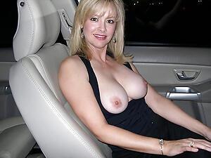 Pretty mature sexy in car photo